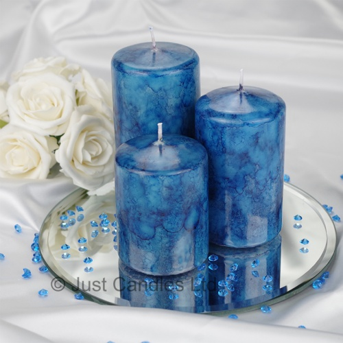 An Aqua Blue coloured marble effect wedding centrepiece pillar candle set with optional glass mirror plate