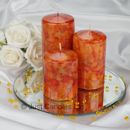 A Burnt Orange coloured marble effect wedding centrepiece pillar candle set with optional glass mirror plate