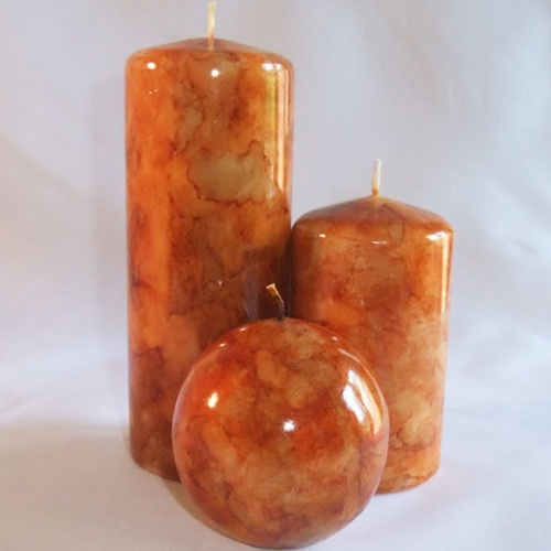 burnt orange coloured marble pillar candle set
