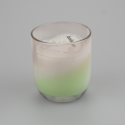 Gentle blends Vanilla and coconut scented Jar candle in a green swirl design.