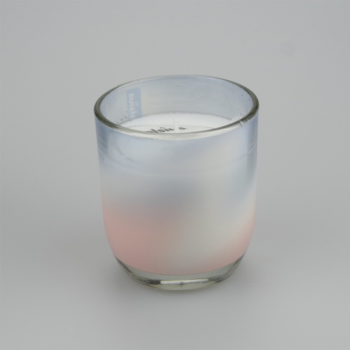 Gentle blends Vanilla and coconut scented Jar candle in a Pink swirl design.