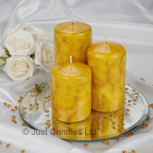A Mustard coloured marble effect wedding centrepiece pillar candle set with optional glass mirror plate