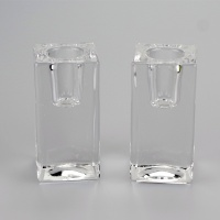 A pair of square glass taper candle holders