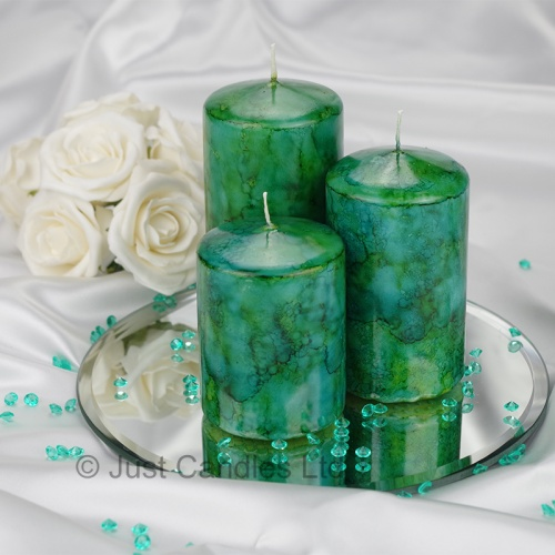 A Teal coloured marble effect wedding centrepiece pillar candle set with optional glass mirror plate