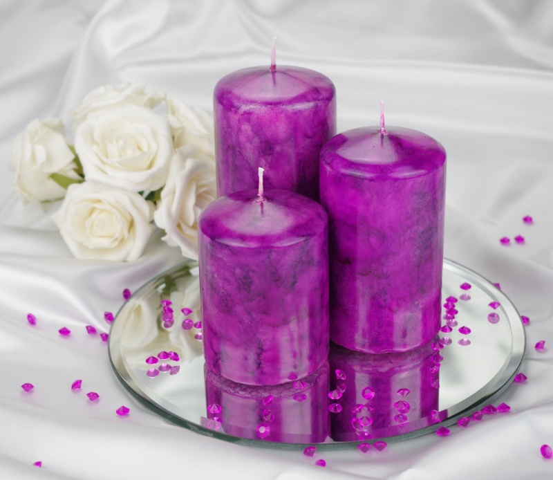 A Violet coloured marble effect wedding centrepiece pillar candle set with optional glass mirror plate