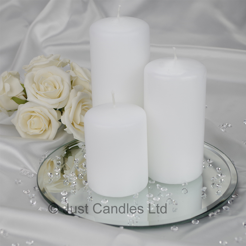 A White Coloured Wedding Centrepiece Pillar Candle Set