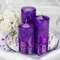 A Cadbury Purple coloured marble effect wedding centrepiece pillar candle set with optional glass mirror plate