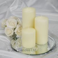 An Ivory coloured wedding centrepiece pillar candle set with optional mirror plate