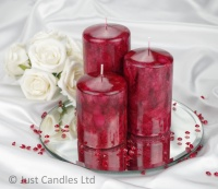 A Maroon coloured marble effect wedding centrepiece pillar candle set with optional glass mirror plate