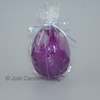 Egg shaped glittery plum ball candle