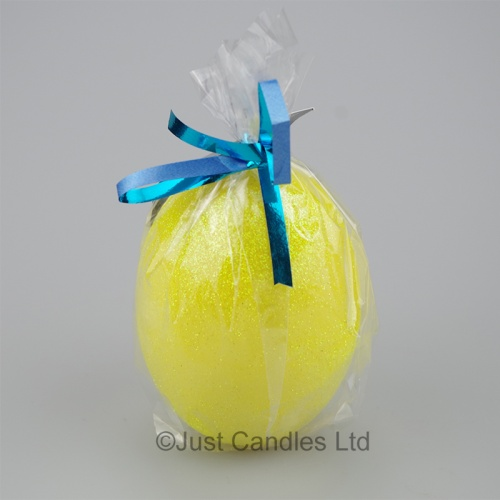 Egg shaped glittery yellow candle