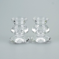 A Pair of stylish glass taper candle holders